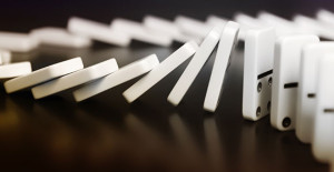 Dominoes lined up and falling