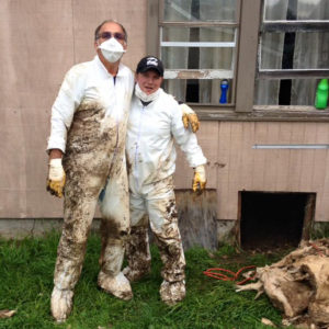 Bruce and Herb after removing flood soaked insulation from a crawl space.