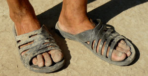 Picture of dirty sandaled feet
