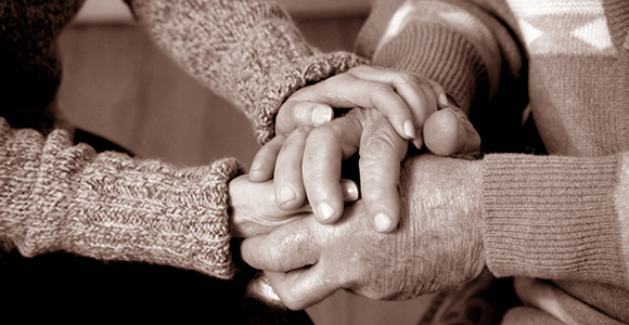 black and white image of hands united