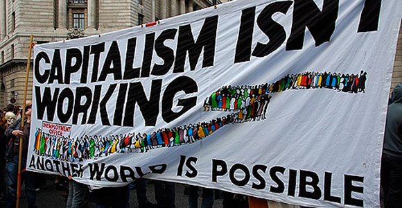 The banner reads: 'Capitalism isn't working: another world is possible'. G20, Meltdown Protest, City of London, Bank of England, 1 April 2009. Credit: Tony Hall.