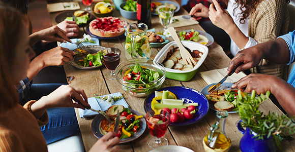 A table with varied people eating