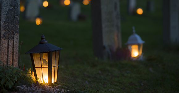 grave yard with lanterns lit