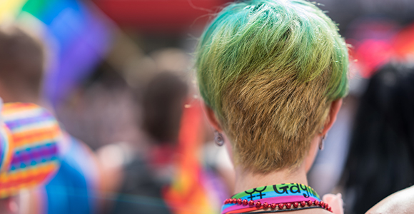 Person with green hair at Pride event