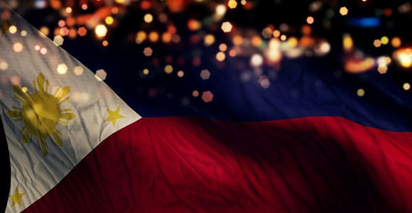 Philippines National Flag Lights at Night in Abstract Background