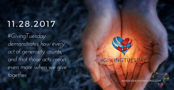 Hands holding #GivingTuesday Logo