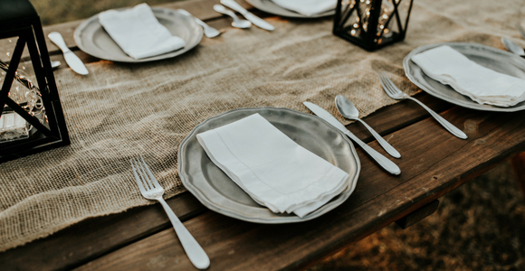 photo of rustic table set for many people