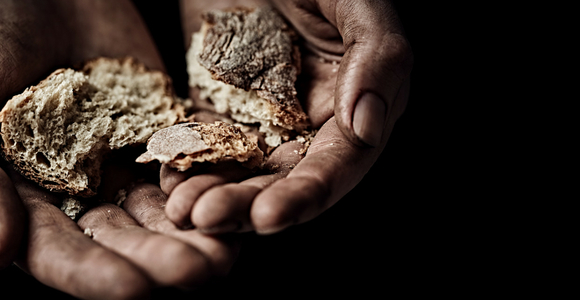 Hands offering bread