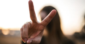 picture of woman holding up two fingers