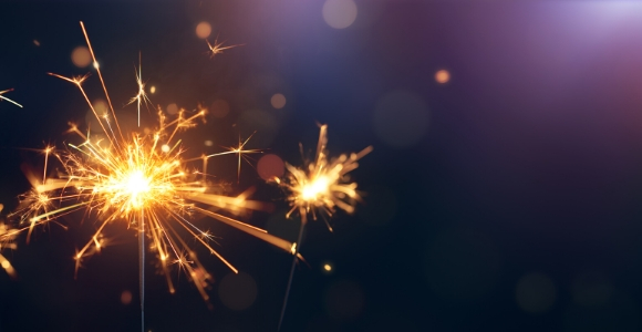 sparkler on purple background
