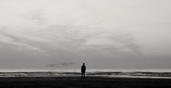 man alone on beach