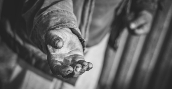 black and white picture of hand to illustrate article