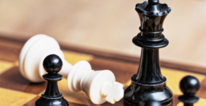 toppling the patriarch in chess pieces